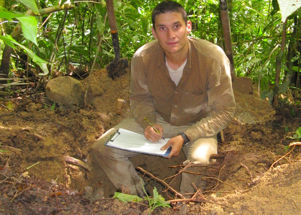 Digging test pits during a soil study.