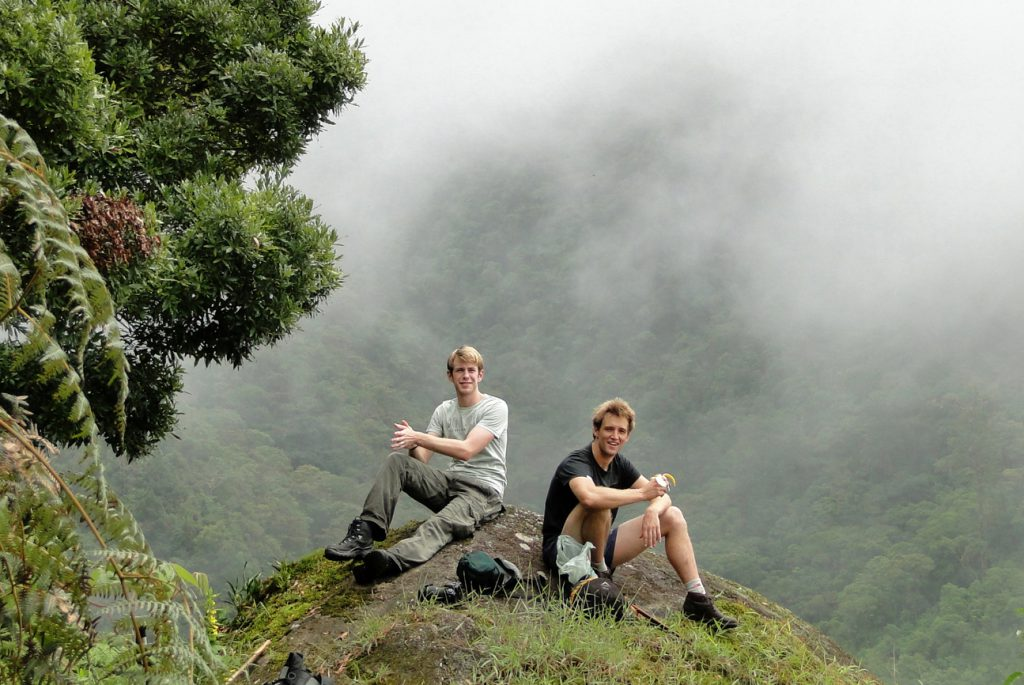 Volunteers taking a break and enjoying the view of the cloudforest from Vulture Rock.